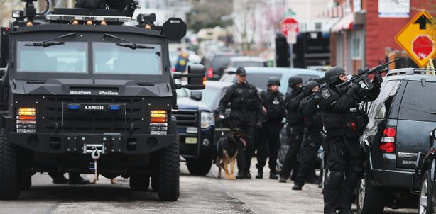 SWAT team members aim their guns as they search for one remaining suspect at an apartment building on April 19, 2013 in Watertown, Massachusetts.