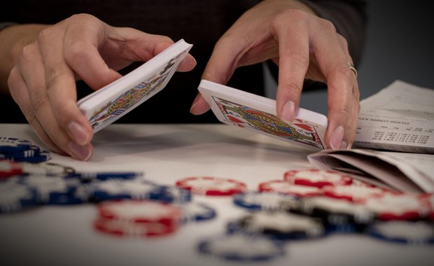 Gambling with chips and a deck of cards. Whether your IRA or 401K will assure...