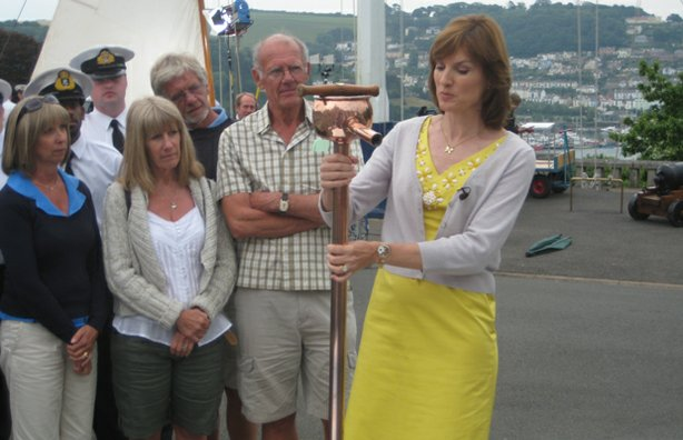 Presenter Fiona Bruce closes the program with a copper pump that used to dispense rum.