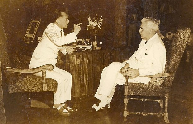 Philippine President Manuel Quezon (left) and U.S. High Commissioner Paul McN...