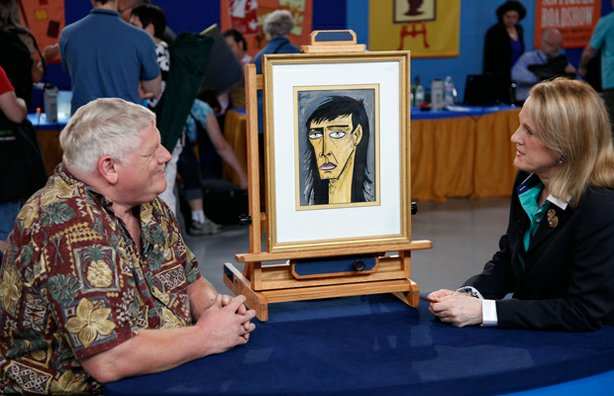 Nan Chisholm Fine (right) appraises a 1955 Bernard Buffet portrait.