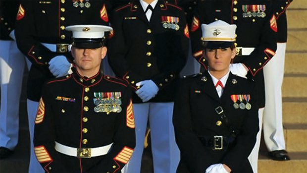 Ariana Klay (right), U.S. Marine Corps 1st Lieutenant, in Marine dress blues.