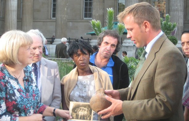 "John Foster (right) sheds some light on a ""Roman"" pot found in the sewers."