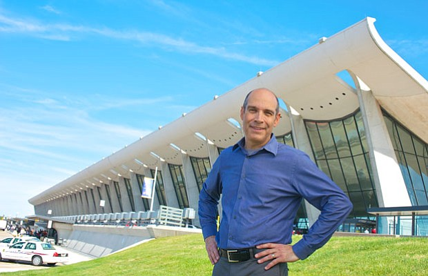 Host Geoffrey Baer at Dulles Airport, in front of the terminal designed by Ee...