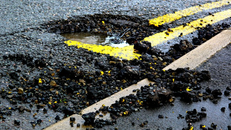 A pothole in a road.