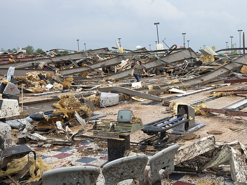 The destruction was wide and devastating in Moore, Okla., on Monday after a t...