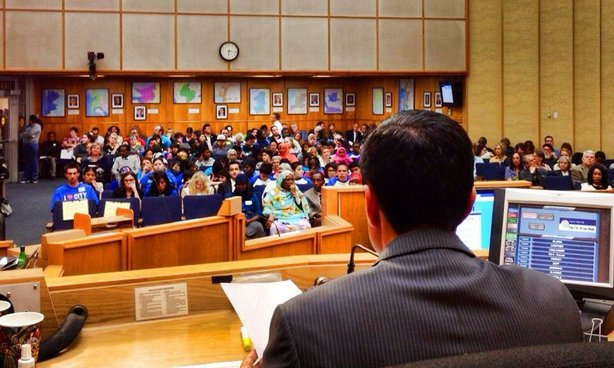 City Council President Todd Gloria looks out at the people filling the San Diego City Council chambers for the public hearing on the Fiscal Year 2014 budget.