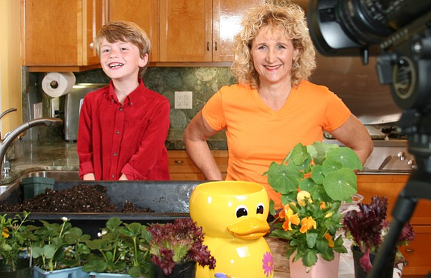 Host Nan Sterman (right) pots plants with John Michael Gerdes.
