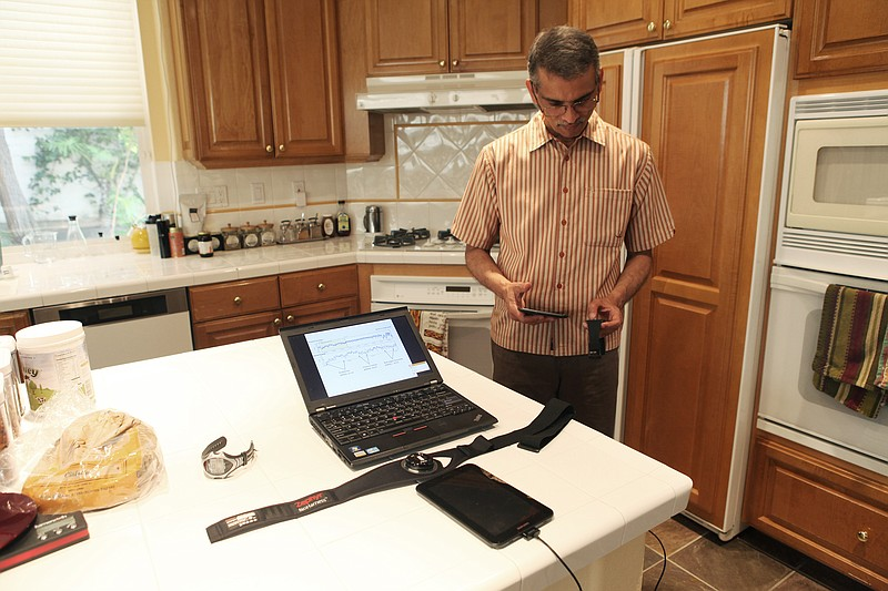 Ramesh Rao, director of the Qualcomm Institute at UCSD, works on the communic...