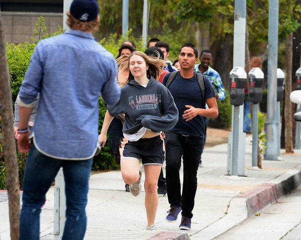 Students rush to safety after shots were fired near the Santa Monica College ...