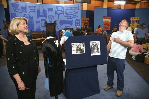 "At ANTIQUES ROADSHOW in Palm Springs, California, this guest (right) brings in the ultimate little black dress worn by Marilyn Monroe in the classic 1959 comedy ""Some Like it Hot"" estimated to be worth a sizzling $150,000 to $250,000."