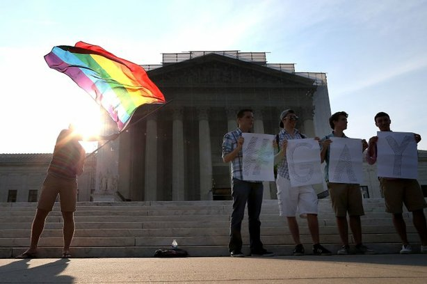 Gay rights activists gather in front of the Supreme Court building on Wednesday.