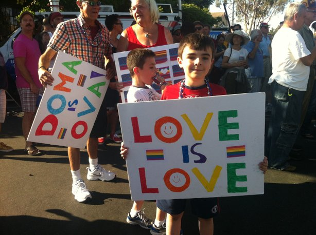 A young child holds a signs supporting same-sex marriage at a post-Supreme Court decision celebration in San Diego's Hillcrest neighborhood, June 26, 2013.