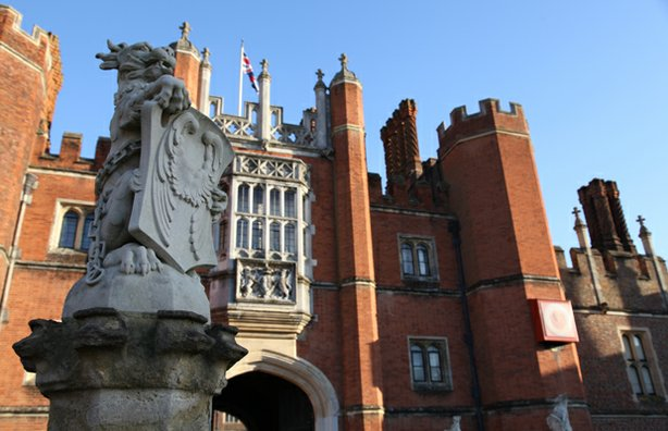 Beast statue in the foreground of the front entrance to Hampton Court.
