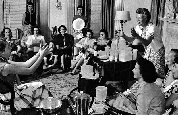 Marketing genius Brownie Wise (right) tosses a bowl filled with water at a Tu...