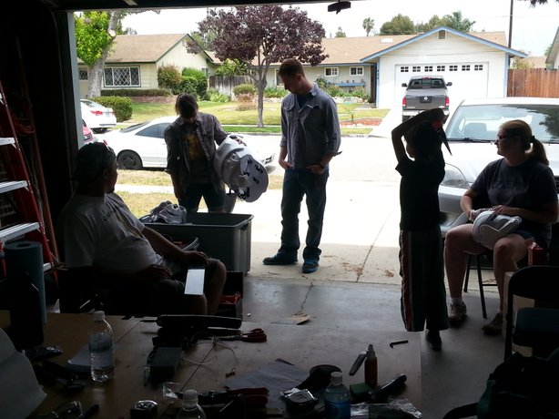 Members of the 501st Legion gather in Drew Hannah's garage to work on their stormtrooper armor.