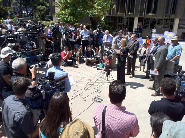 Donna Frye, joined by attorneys Cory Briggs and Marco Gonzalez, speaks to reporters at a press conference Monday, July 15 about sexual harassment allegations against Mayor Bob Filner.
