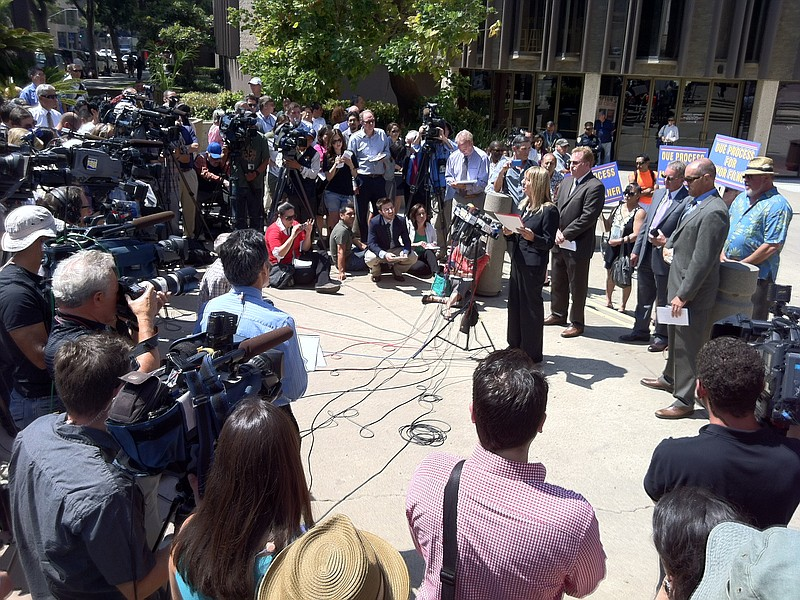 Donna Frye, joined by attorneys Cory Briggs and Marco Gonzalez, speaks to rep...