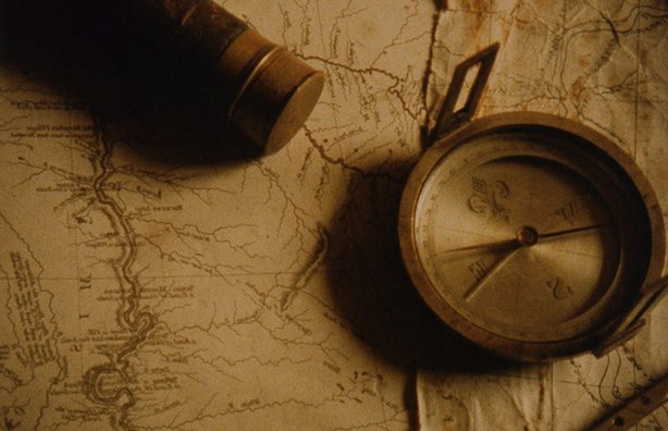 "Promotional photo of a map and compass for the film, ""Lewis & Clark: The Journey Of The Corps Of Discovery."" This film tells the remarkable story of the United States' first exploration of the West, a voyage of danger and discovery from St. Louis to the headwaters of the Missouri River, over the Continental Divide to the Pacific. Hal Holbrook narrates."
