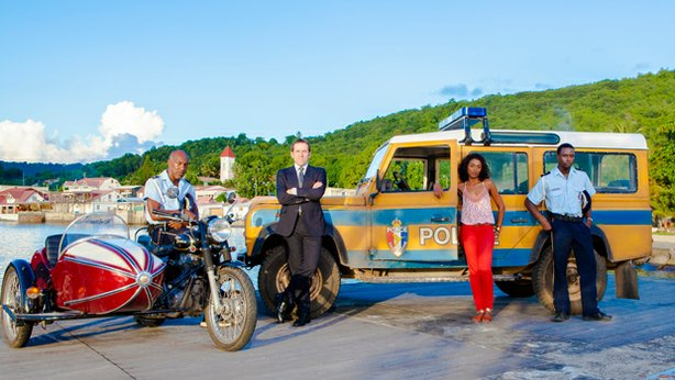 Danny John-Jules as Dwayne Myers, Ben Miller as DI Richard Poole, Sara Martins as Sergeant Camille Bordey and Gary Carr as Fidel Best in season two of DEATH IN PARADISE.