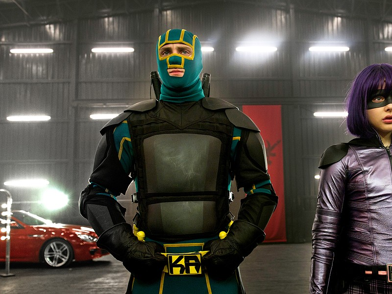 Kick-Ass (Aaron Taylor-Johnson) and Hit Girl (Chloe Grace Moretz) come out of...