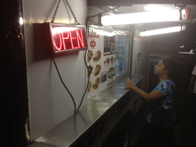 A woman orders from the Datapoint Taqueria food truck in San Antonio.