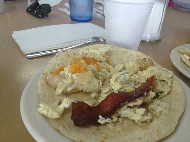 A bacon, egg, potato, and cheese taco.