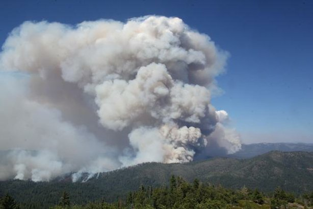 This undated photo shows smoke billowing from the Rim Fire as seen from Pilot...
