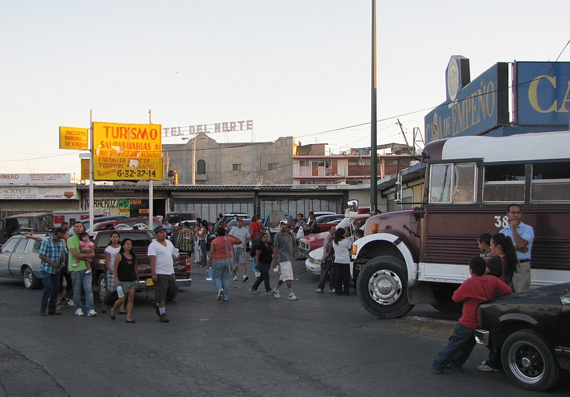 Shoppers crowd an outdoor market in downtown Juárez.