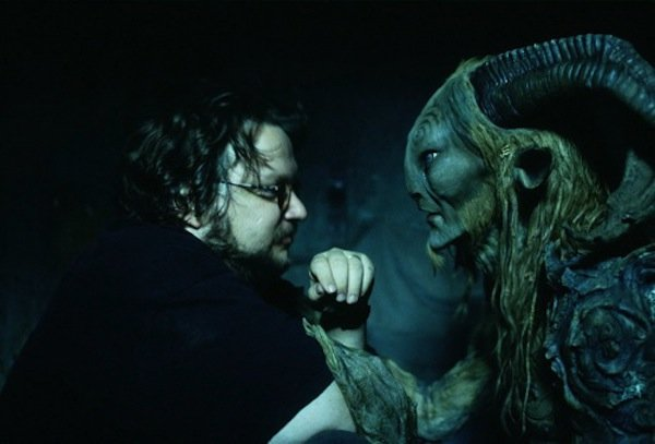 "Director Guillermo Del Toro and suit actor Doug Jones on the set of ""Pan's La..."