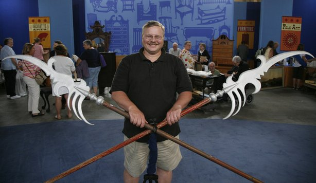 "At ANTIQUES ROADSHOW in Grand Rapids, Michigan, this lucky guest beams proudly after appraiser Kathleen Guzman declares his pair of prop spears were indeed used in the 1939 classic film ""The Wizard of Oz"" and are estimated to be worth $30,000."