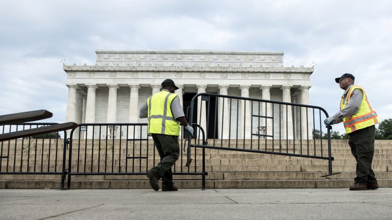Members of the U.S. Park Service place barricades around the Lincoln Memorial...