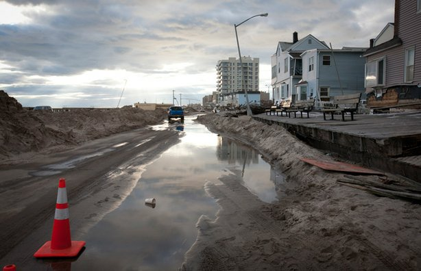 Water soaked roads filled with sand from beach in Rockaway Beach, Queens, an area affected by Hurricane Sandy on November 3, 2012.