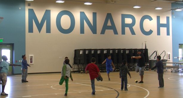 Students at Monarch School do stretches during physical education class on Oc...