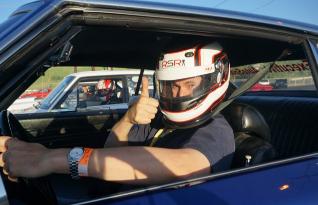David Pogue gets ready to race in sports car.
