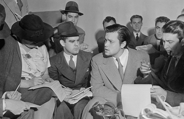 Orson Welles explaining his radio broadcast at a press conference, October 31...