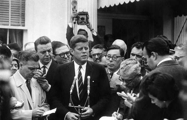 President-elect John F. Kennedy speaks to the press outside the White House r...