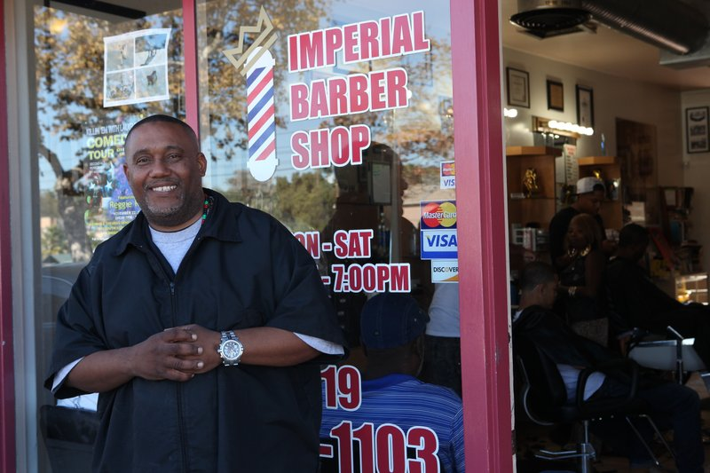 Mario Lewis owns the Imperial Barbershop. He believes the public artwork prop...