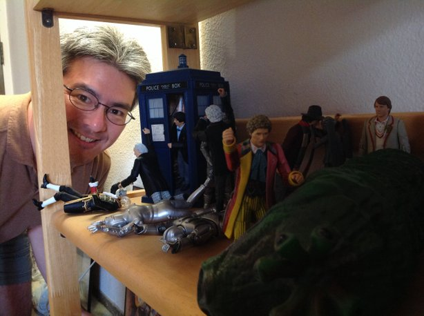 "Dr. Ramie Tateishi with his 50th anniversary display of ""Doctor Who"" figures."