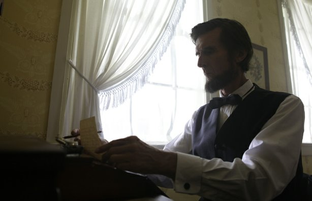 "Reenactment of Lincoln writing the Gettysburg address at David Wills house in ""Lincoln@Gettysburg."""