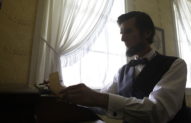 Reenactment of Lincoln writing the Gettysburg address at David Wills house in...