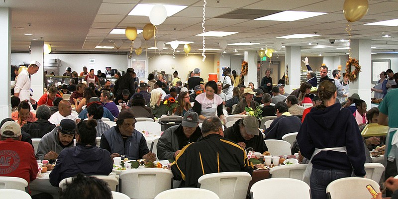 Hundreds of people eat a Thanksgiving meal at the San Diego Rescue Mission.