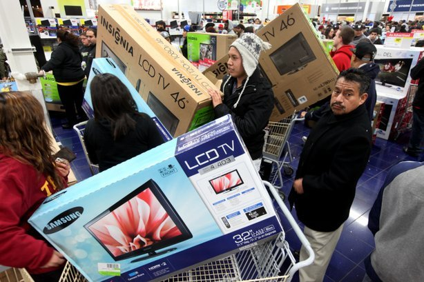 Customers shop for electronics items during 'Black Friday' at a Best Buy store in San Diego.