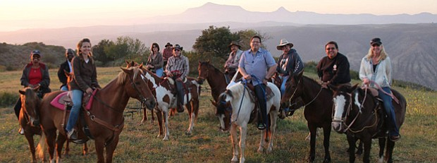 CROSSING SOUTH host Jorge Meraz (center front) rides horseback with friends f...