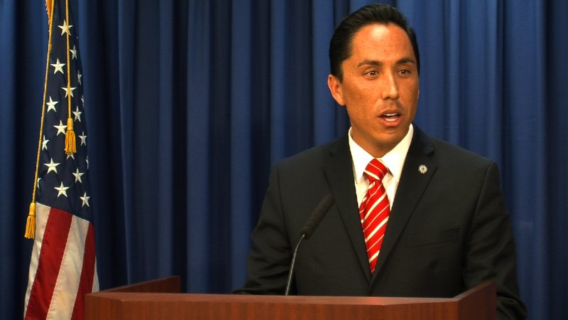 Interim Mayor Todd Gloria talks to reporters in City Hall.