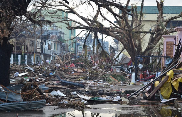 Debris lines the streets of Tacloban, Leyte island on November 14, 2013, near...