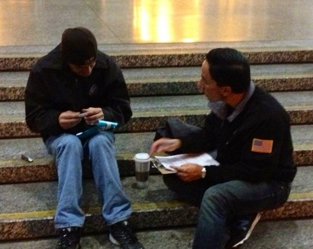 Interim Mayor Todd Gloria helps survey homeless people in downtown San Diego for the 2014 WeAllCount homeless census.