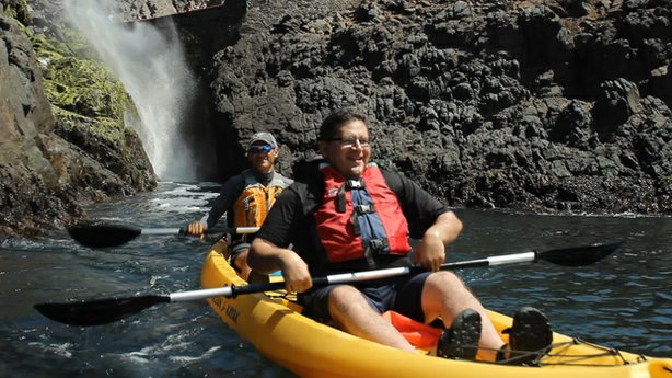 In a kayak, host Jorge Meraz (front) gets up close and personal with the La B...