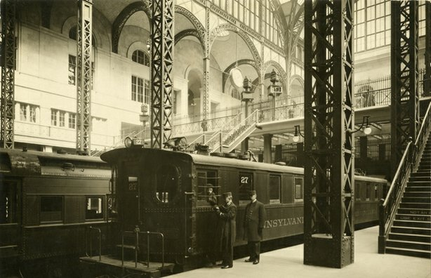 Operating staff consulting with train engineer on platform, 1910.