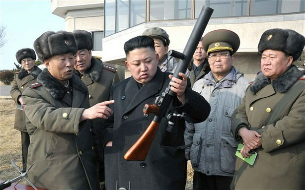 North Korean leader Kim Jong-un inspects a gun during an artillery firing drill of the Korean People's Army.